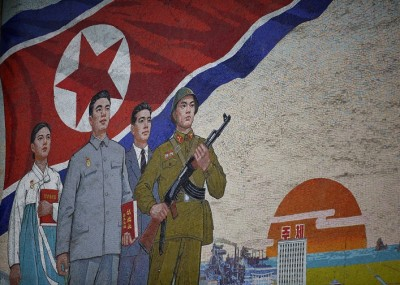 PYONGYANG, NORTH KOREA - APRIL 02:  Propaganda mural painting is seen outside People(degrees)?s Palace of Culture on April 2, 2011 in Pyongyang, North Korea. Pyongyang is the capital city of North Korea and the population is about 2,500,000.  (Photo by Feng Li/Getty Images)
